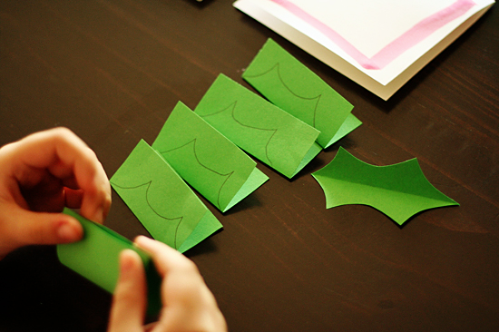 Cutting paper holly leaves
