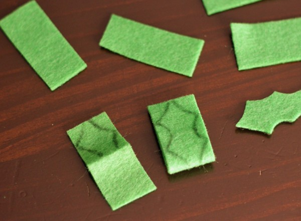 Cutting green felt holly leaves