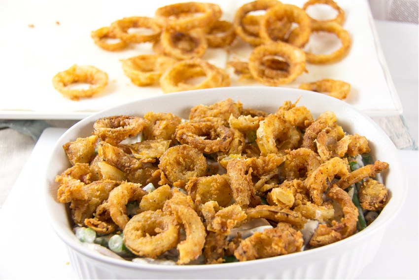 green bean casserole made with deep friend onion rings and fresh produce