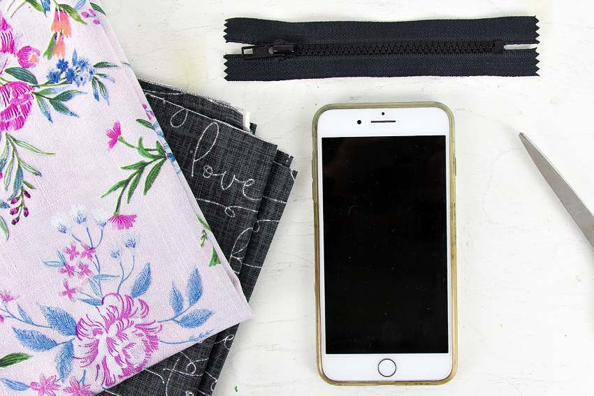 a phone and fabric to measure for a phone purse