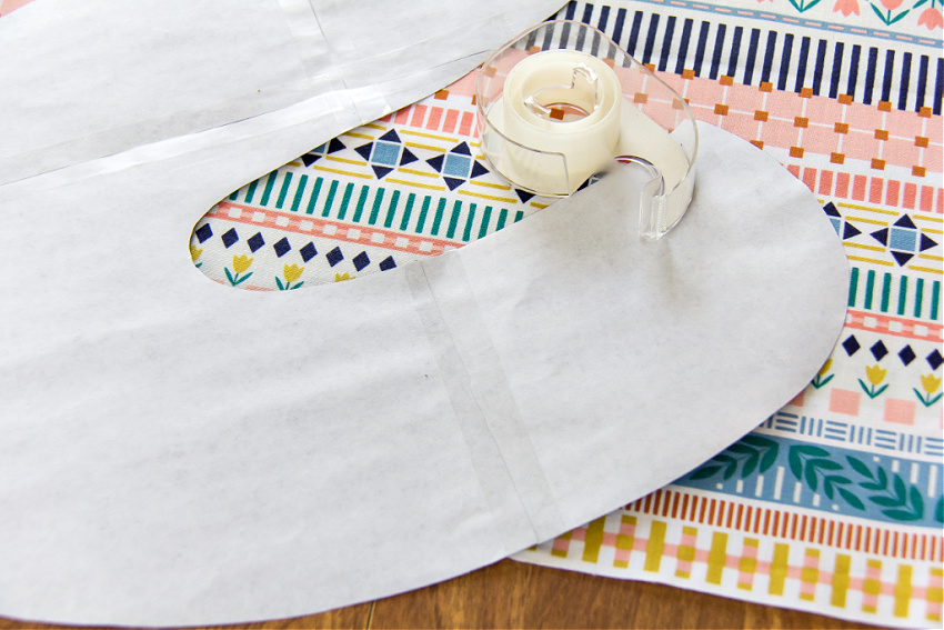 a letter s being taped together to make a fabric template