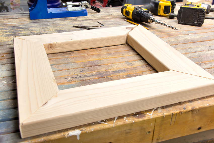 pine wood cut into four pieces that fit together like a picture frame