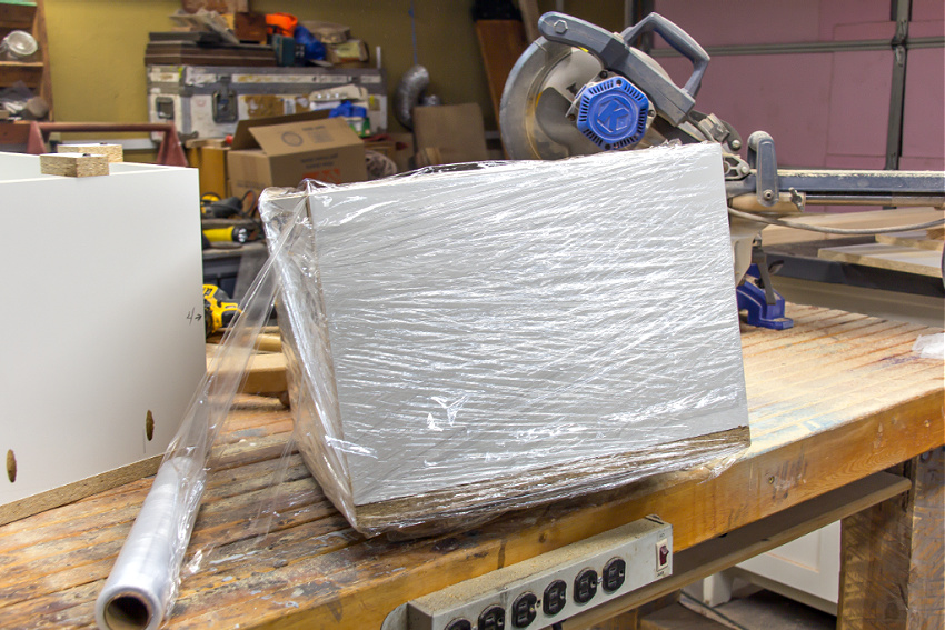 a wood box wrapped in cling wrap