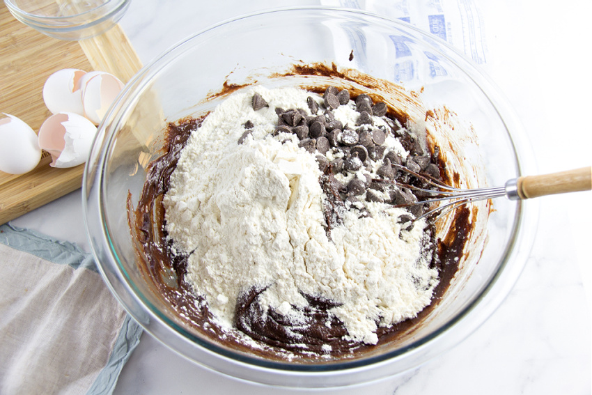 add flour and chocolate chips to brownie batter