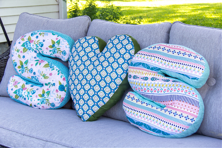 letter s and heart shaped pillows