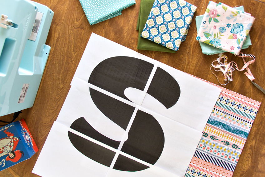 a letter s template on top of patterned fabric