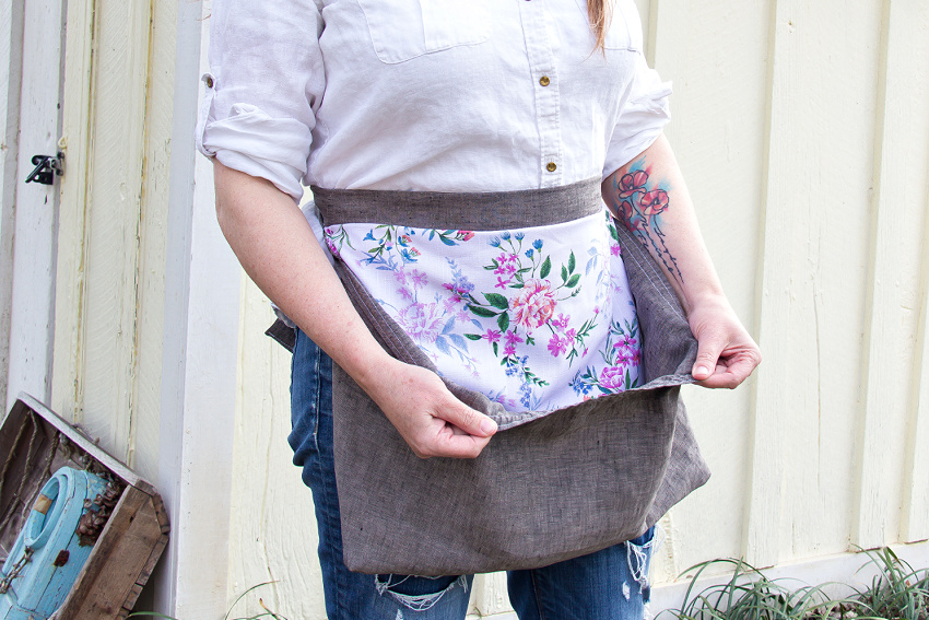 a large pocket sewn onto an apron for collecting vegetables and eggs