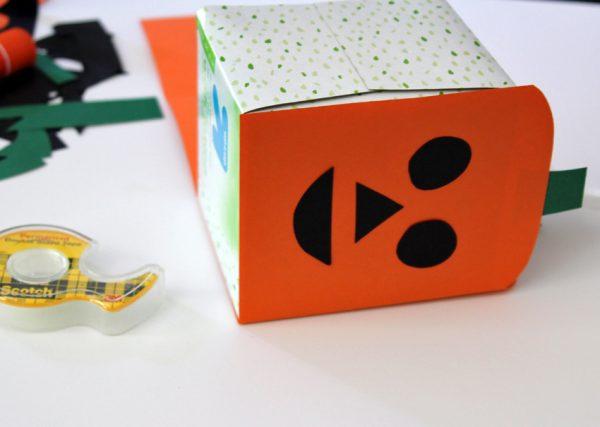 Making a jack-o'-lantern tissue box