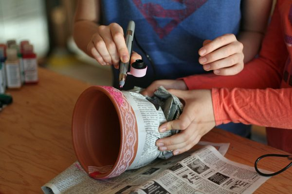 Lace ribbon stenciling on flower pots