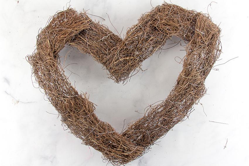 a natural vine heart shaped wreath