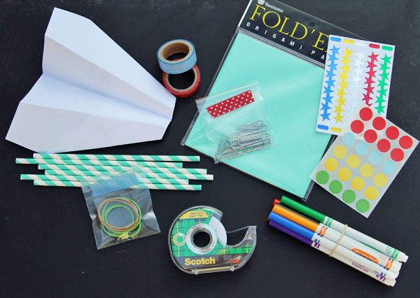 Supplies for a paper airplane kit