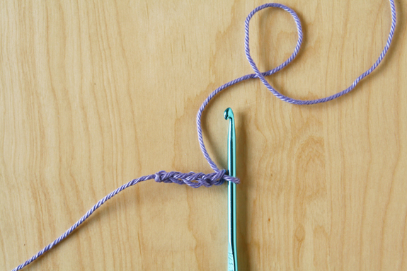 Stitching a Crochet Bunting by caughtonawhim.com for @makeandtakes.com #crochetaday