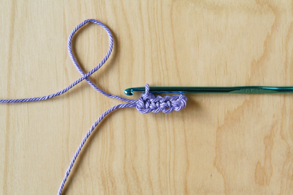 Crochet Bunting Necklace Pieces by caughtonawhim.com for @makeandtakes.com #crochetaday