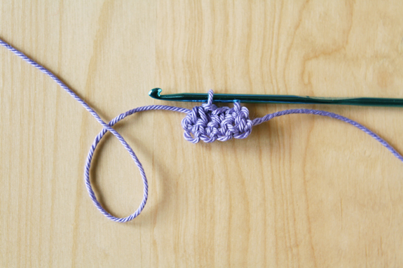 Crocheting Small Bunting Triangles by caughtonawhim.com for @makeandtakes.com #crochetaday