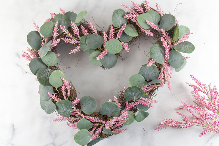 the making of a handmade valentines day pink wreath