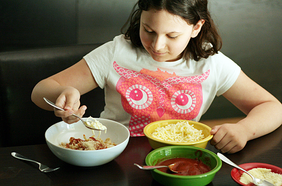Cooking pizza pasta bowls with kids