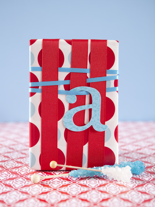 start with a wrapped present two ribbons in different widths and