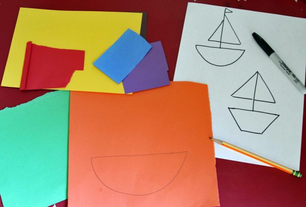Rainbow sailboat art with simple shapes