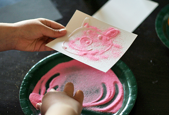 Colored sand and glue drawings