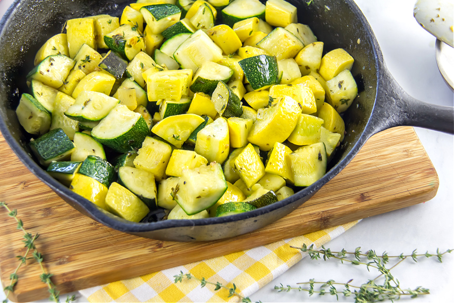 sauteed zucchini and summer squash in a cast iron skillet