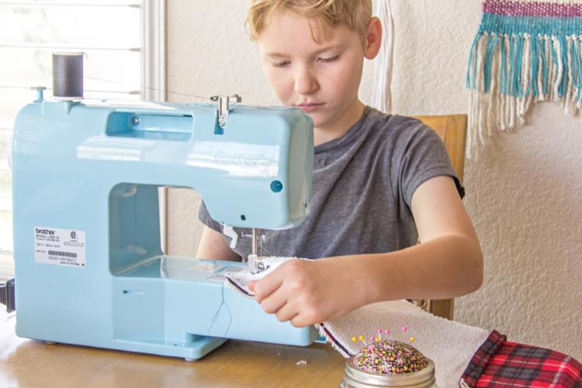 a boy sewing