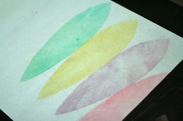 Chalk pastel stenciled feathers
