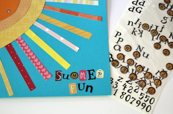 Journal cover with paper collage and letter stickers