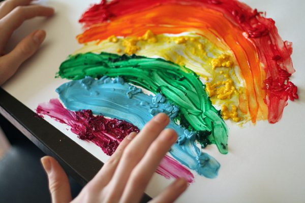 Painting with homemade textured finger paints