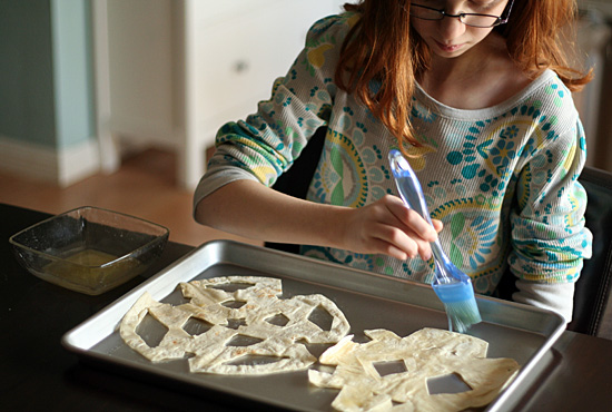 Making tortilla snowflakes