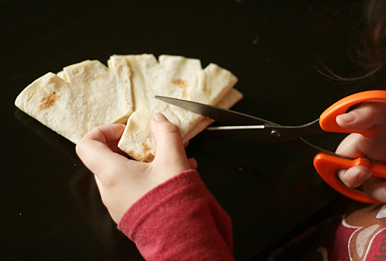 Cutting snowflakes with tortillas