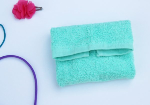 Craft a washcloth purse that holds a bar of soap