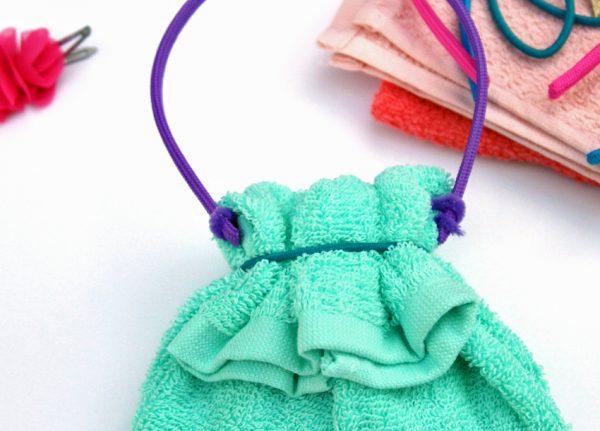 Washcloth purse with headband handle