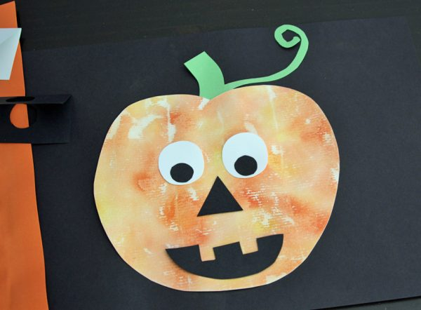 Watercolor and gauze painted jack o' lantern craft for kids