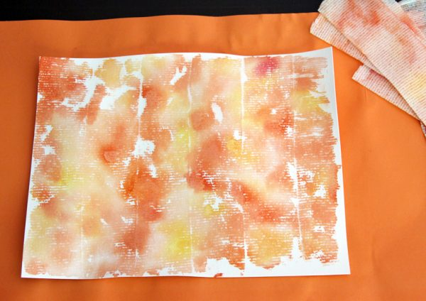 Painted paper with watercolors and gauze