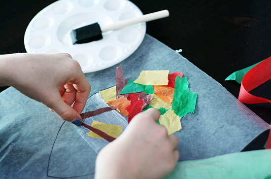 Gluing tissue paper to wax paper
